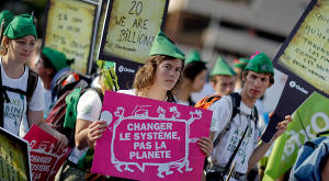 Demonstrators in Nice, France, last month urged the leaders of the Group of 20 nations to do more to help the poor by means of the 'Robin Hood tax' � a tiny levy on trades in the financial markets that would take money from the banks and give it to the world�s poor.  Photo: Frederic Nebinger/Getty Images