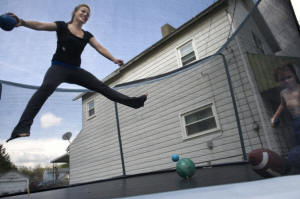 Teenage woman on trampoline. In a Rust Belt town, a teenager�s climb from poverty: Tabitha Rouzzo yearns to take a different path than those around her in New Castle, Pa., but leaving poverty requires a more exhaustive effort than it once did in America. Photo: Linda Davidson/Washington Post
