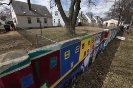 A section of a half-mile long concrete wall, six feet tall and a foot or so thick, now covered with murals, built in the 1940s is shown in Detroit, March 28, 2013. The wall was built with a simple aim�to separate blacks and whites.