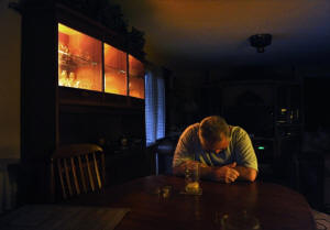 Lonnie Briglia, 60, paused to compose himself as he told of the losing battle with the bank to save the family home in Port St. Lucie, Fla. �It's like life is a big doughnut and I fell through the hole,� he said. He�s inside the small trailer he bought for $750 after losing the family home to foreclosure, and he has been on the fence about whether he would take part in SNAP but said might do it if desperate