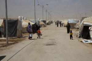 This road through the Zaatari refugee camp has been named Champs Elys�es. Arab men come scouting around here for virgins. Photo: Liny Mutsaers/IPS.