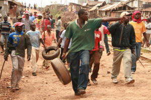 Youth in Kenya�s Kibera slums carry crude weapons ready to fight youths from the rival side. Three people were killed in the January 2008 confrontation Photo: Julius Mwelu/IRIN
