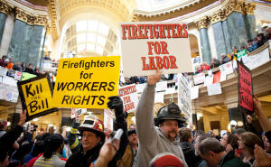 Picture showing workers in Wisconsin state capital building.  Workers fought changes in labor laws in Wisconsin last year. the total number of union members fell by 400,000 last year, to 14.3 million, even though the nation�s overall employment rose by 2.4 million. Photo: Max Whittaker/New York Times