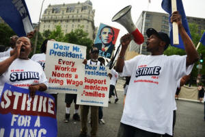 Low-wage workers picket outside federal buildings in Washington, DC.