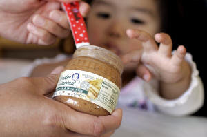 Baby being fed baby food. Photo: Paul Sakuma/AP Photo