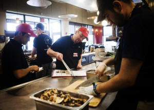 Scott Newman, center, manager of the Boloco burrito restaurant in Concord, N.H., said the above-average pay enabled him to pick from among many talented job applicants. Photo: Andrea Morales for The New York Times