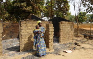 Woman farmer standing in front of her destroyed house in Bessan, a village in northwest CAR, which suffered considerable destruction at the hands of Seleka rebels. Photo: Nicholas Long/IRIN