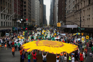 Over 300,000 people marched in New York City Saturday September 20, 2014 to protest the slow pace of action against climate change. hoto: Damon Winter/New York Times