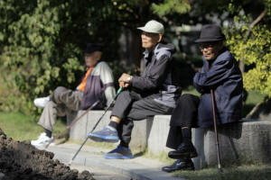 Elderly men sit on benches at Tapgol Park in the Jongro-gu area of Seoul. South Korea has risen from the economic ashes, but its old are increasingly poor. Photo: Woohae Cho/Bloomberg