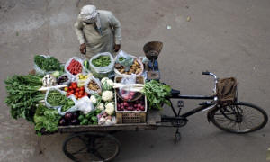 A vendor in New Dehli sells vegetables from a cart.  Photo: Manpreet Romana/AFP/Getty Images