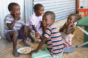 Children in Namibia eat a meal made from products sourced from their field. Photo: Jaspreet Kindra/IRIN