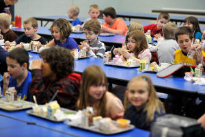 Children eating lunches at school. Photo: Nabil K. Mark/Centre Daily Times, via Associated Press