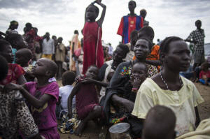 Internally displaced people wait to register for food distribution at a camp at the base of the United Nations Mission in South Sudan in Bentiu, South Sudan.  Photo:Lynsey Addario/New York Times