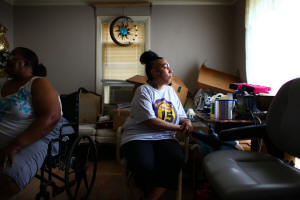 Jasmin Almodovar, right, a home health aide in Cleveland, has received no increase in her hourly pay of $9.50 since 2007, even as costs for necessities have risen. Photo:  Michael F. McElroy/The New York Times