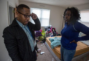 Lamar Smith, a case worker with the city-contracted nonprofit Community of Hope, does a walk-through in mid-December with Timika Holiday, 29, a formerly homeless mother of two, at her home in the District. Photo: Evelyn Hockstein/Washington Post