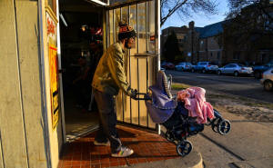 Paul and his daughter head home after attending a fatherhood development class at Next Door Foundation. Photo Jah i Chikwendiu/The Washington Post