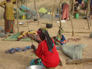 A displaced woman sets up camp in Mali's Timbuktu region. Photo: Africare