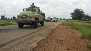 Nigerian army vehicle driving along a highway.  Photo: Nigerian Defense Headquarters