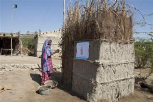 In this March 3, 2015 photo, a Pakistani villager builds a toilet in Thatta district. Photo: Associated Press