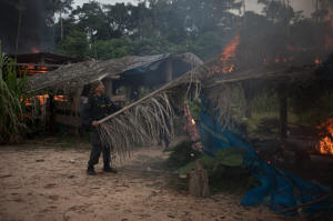 Peruvian National Police burn an illegal gold mining camp in the Madre de Dios region of the Peruvian Amazon. Photo: Dominic Bracco II/Prime for The Washington Post