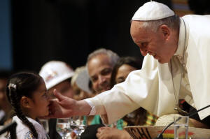 Pope Francis greets a child in Santa Cruz, Bolivia, on Thursday. Photo: Gregorio Borgia/Associated Press