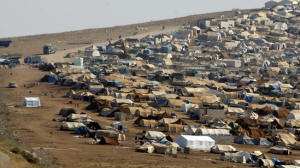 Climate change probably worsened the drought that preceded Syria's uprising, a new study suggests. Here, a refugee camp is seen in Syria near the Turkish border town of Cilvegozu. Photo: Gregorio Borgia / Associated Press)
