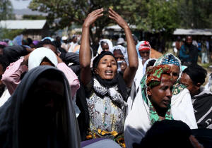 Women mourn at the funeral for Dinka Chala, a schoolteacher who family members said was shot to death by military forces during a protest in Holonkomi, in the Oromo region of Ethiopia. Photo: �  Tiksa Negeri/Reuters