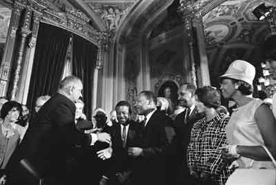 President Lyndon B. Johnson, Martin Luther King, Jr., and Rosa Parks at the signing of the Voting Rights Act on August 6, 1965 Photo: