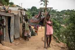 A girl stands beside a laundry line in a poor neighborhood overlooking Cabinda, a heavily guarded territory that accounts for half of Angola's oil output. Photo: Nichole Sobecki/The Washington Post