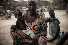 20-month-old Ummi Mustafa and her mother, Maiduguri, Nigeria. The latest red flag from FEWS NET draws particular attention to places like Banki Town and Bama in Borno State, where the threat of Boko Haram violence continues to limit movement and prevent humanitarian access. Photo: Credit: Guy Calaf/Action Against Hunger USA