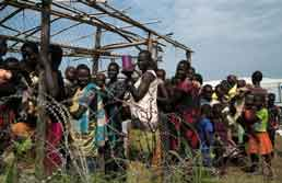 South Sudanese women and children queue to receive emergency food July 25, 2016, at the U.N. protection of civilians (POC) Site 3, which hosts about 30,000 people displaced during the recent fighting in Juba, the capital of South Sudan. Photo: Adriane Ohanesian/Reuters