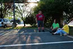 From left are Scott Downey, 52; John Baird Jr., 47; and Kathleen McDermott, 81. The three friends live in their cars. After getting a free dinner, provided by area churches, they sit on a curb in a Fairfax County Home Depot parking lot and visit as the sun sets. Photo: © Sarah L. Voisin/The Washington Post