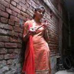 "Ginni Mahi at her home with a Punjabi folk instrument called a ""thumbi."" Photo: Rama Lakshmi/The Washington Post"