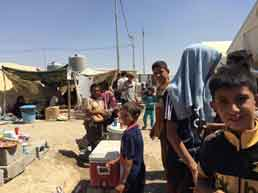 Internally displaced children play at the Debaga camp in the Kurdistan Region of Iraq. Photo: © UNHCR / Caroline Gluck