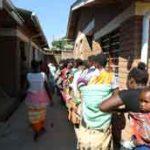 Women waiting to enter the Ndirande Health Center in Blantyre,Malawi. Photo: WHO/ZakwathuCommunication