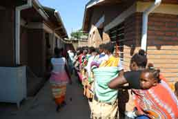 Women waiting to enter the Ndirande Health Center in Blantyre,Malawi. Photo: WHO/ZakwathuCommunication