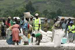 Residents of an IDP camp in North Kivu, Democratic Republic of the Congo receive food rations distributed by WFP. Photo: WFP