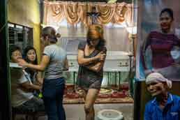 The wake for Jenniffer Discargar, who was killed near Manila by masked gunmen in October. Photo: Moises Saman/Magnum, for The New York Times